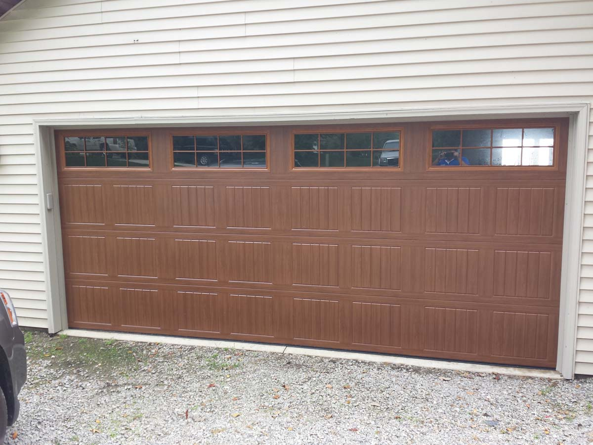 Residential sectional doors dennys door company in celina ohio 8300 golden oak sonoma stockton iii windows resi sectional rubansaba